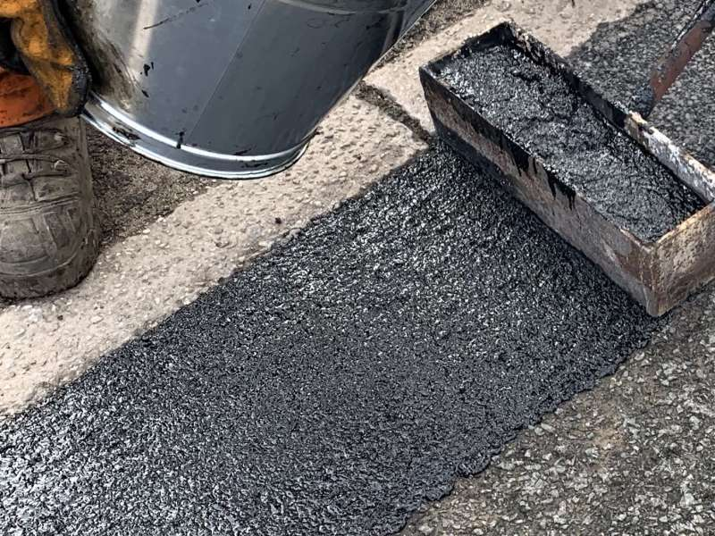 Elastomac rubberized road repair material