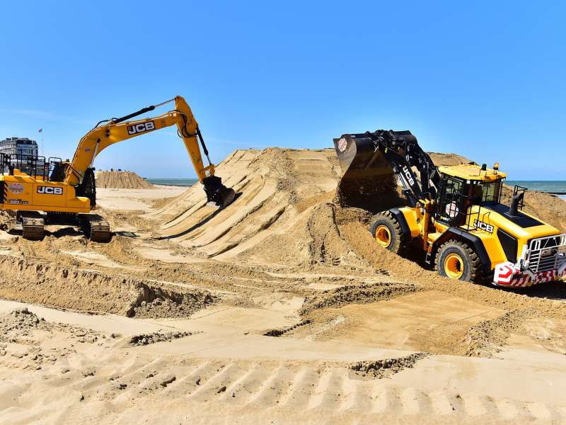 JCB machines on the beach