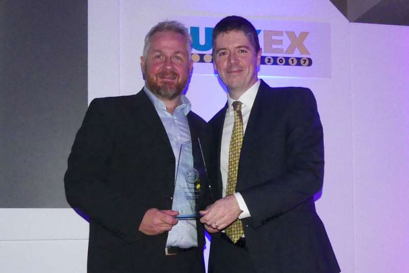 Philip Trimble (left) receives MHEA Innovation Award